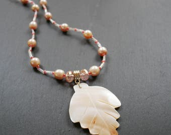 Sparkly mauve crystal necklace with fresh water pearls and Mother-of-Pearl pendant