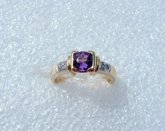 Amethyst and Diamond yellow gold ring-9 carat ring set with an Amethyst and 2 diamonds.