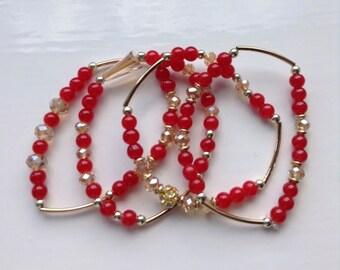 Amici. Set of red bracelets