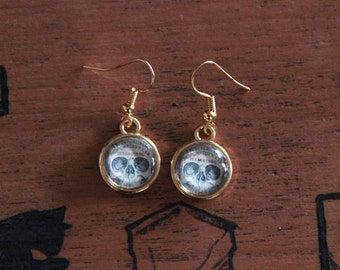 BALANCES skull Ouija golden earrings