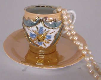 Vintage Lusterware teacup and saucer, opalescent gold, ornate raised flower front, one of a kind, hallmark on bottom