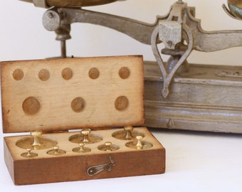 Box set of eight vintage brass weights