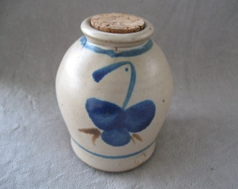 pottery jug with blue flower