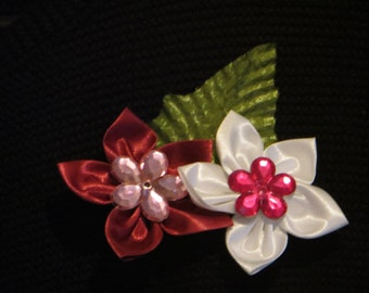 Lapel pin with a red and white flower