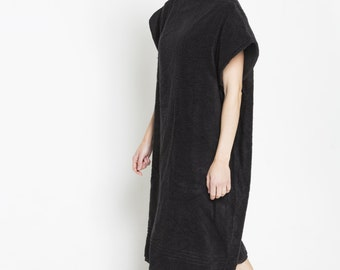 Changing Poncho in Black
