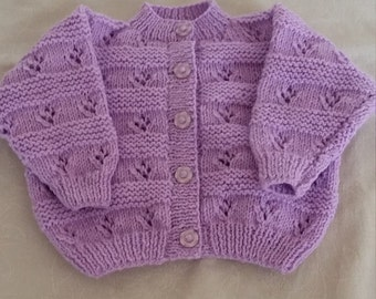 Hand knitted baby girls cardigan