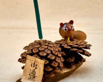 Tanuki racoon figurine. Pine-corn essence stick holder. Tanuki racoon figurine.