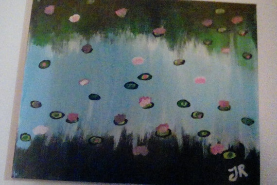 Lily pads on a pond of reflection