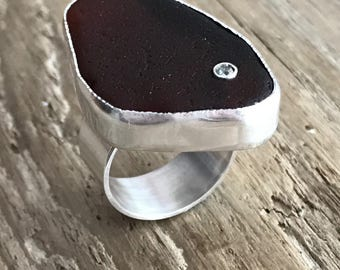 Natural beach glass sterling silver ring with cubic zirconia.