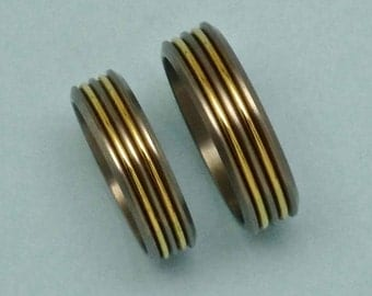 Titanium and 14 carat gold pair of rings / weddingbands.