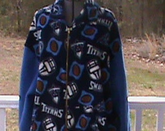 Fleece Coat, team Titans, very warm for football weather. With side pockets cuffed sleeves.