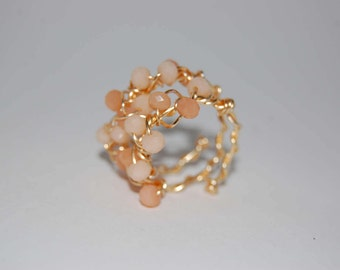 Ring spiral Golden crystals. Spiral ring with crystals. Pink and gold ring. Golden ring. Pink ring. Golden ring. Soft pink ring.