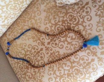 Wood necklace, black tassel, pom poms blue