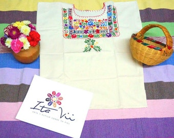 By Oaxacan women artisans hand-embroidered blouse