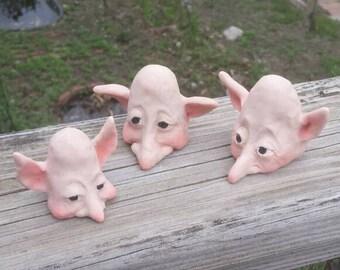 Three knomes peeking out at you!