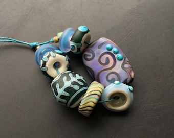 Handmade lampwork glass bead set by Lori Lochner Rustic Tribal purple and teal eclectic glass necklace mix artisan jewelry design supply