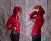 Red zip front hoodie. Spring jacket with elbow patches, stripe cuffs, gold zipper and kangaroo pocket. Vegan leather accents, gold aglets.
