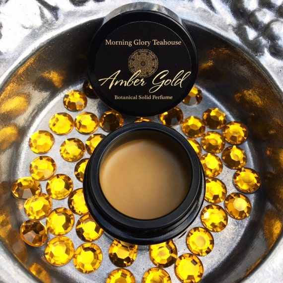Amber Gold Botanical Solid Perfume ~ smoky, dry-wood amber and precious resins delicately blended with earth, sweetness, & gold dust