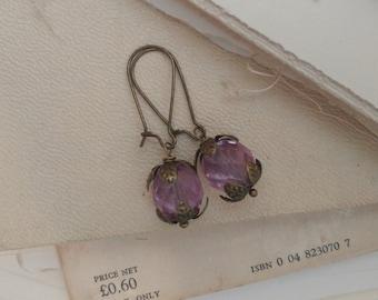 Purple faceted flower bud drop earrings.