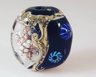 Lampwork focal bead with handmade murini