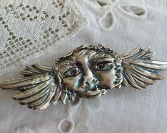 spirit of the night - winged moon face as a silver pin
