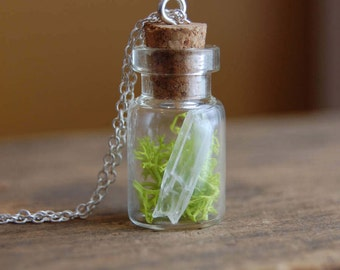 captured. miniature terrarium bottle charm necklace with live moss and quartz crystal point.