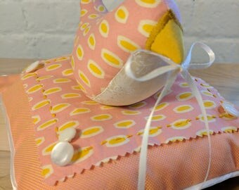 Retro Pink and Yellow Ring Bird on a Pillow