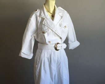 white denim pantsuit 80s vintage bedazzled rhinestone cz gold studs 1980s one piece onesie romper lapel collar waist belt glam rock medium M