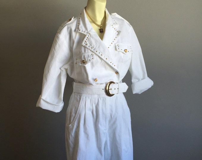 Featured listing image: white denim pantsuit 80s vintage bedazzled rhinestone cz gold studs 1980s one piece onesie romper lapel collar waist belt glam rock medium M