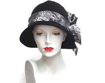 Black flapper style cloche hat with black and white toile de jouy fabric decoration - average size 22.5 inches