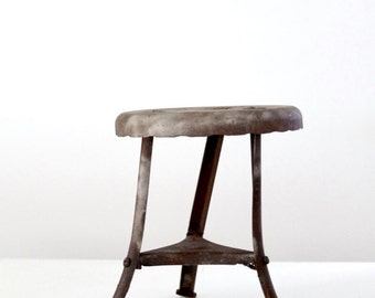 antique milking stool, small metal stand