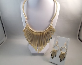 Gold Tone Bib Choker Necklace with Gold Tone Pendants and Marching Earrings