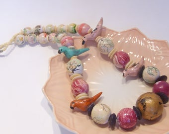 Large Wood Bead Necklace with Carved Birds