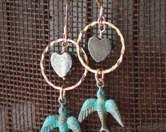 Seraphina Earrings: Verdigris brass birds dangle beneath faceted golden rings & pyrite hearts wire wrapped on 14k gold filled wire, ear wire
