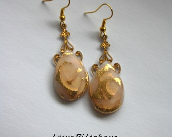 Polymer Clay earrings with gold leaf.