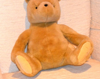 "CLASSIC GUND POOH, by Disney. Lg. 13"" from head to backside,16""ear to toe. Ex.Vintage Cond. except a rub on bottom of rt. foot. See Pic."