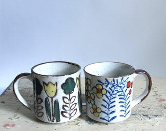 Vintage Pair Stoneware Mugs // Two light gray coffe cups with colorful floral glazed design