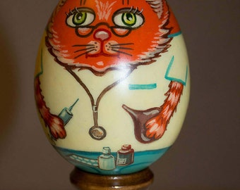 Gift wooden egg with a cat doctor