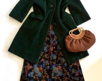 Fabulous 1950s black and green wool bouclé three button overcoat with front flap pockets