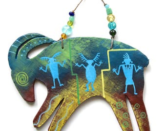 southwest spirit Native American Indian desert bighorn sheep ram abstract dancing figures rock art petroglyphs beads Santa Fe New Mexico