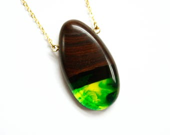 Egg shaped pendant / necklace handmade from dark Australian wood and a mixture of avocado green and emerald green resin