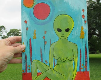 pretty naked alien sitting in a field of flowers painting, three breasts, female alien, weird, unique,  alien art, ufo, outerspace, bold