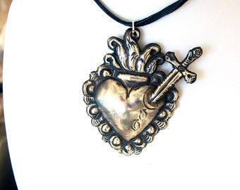 Large vintage .800 sterling silver pendant, dagger in heart, very classic, southwestern