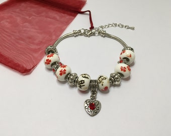Charm's red and white with ref 825 heart charm bracelet