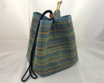 NEW - Project Bag, Knitting Bag, blue/green/copper stripes, black cotton cord, wooden bead closure, blue ultrasuede lining