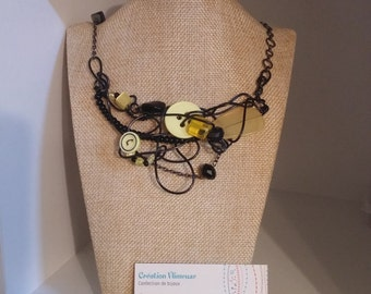 Yellow madness necklace, button, black wire
