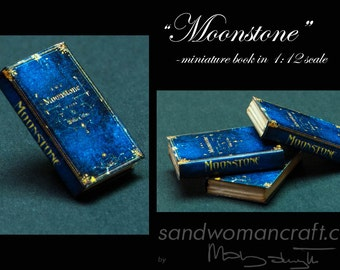 Dollhouse miniature book Moonstone in 1:12 scale. Paper non- openable pages, paper cover (blue/yellow), 25 mm high for 1 inch scale.