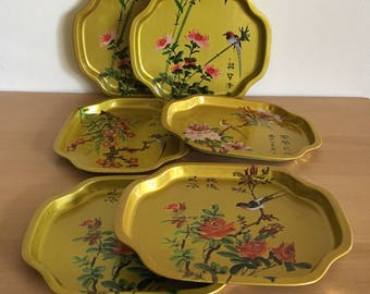 Lovely vintage set of 6 petite gold metal trays from Hong Kong features colorful birds and Chinese letters for tropical Old Florida home!
