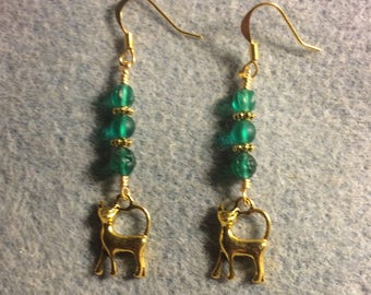 Small gold cat charm dangle earrings adorned with teal Czech glass beads.