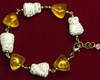 Amber Bead And Porcelain Cat Bracelet